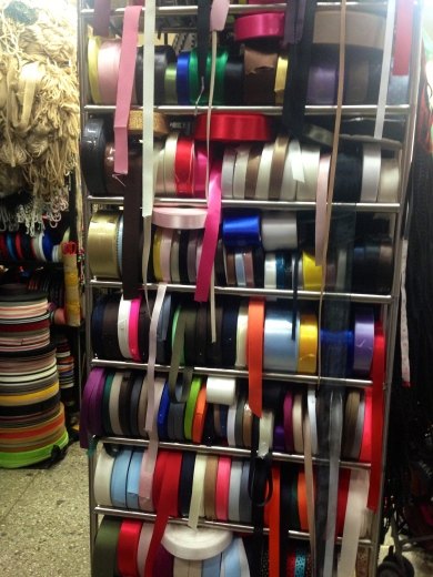 giant rack of multicolored ribbons stacked hodgepodge